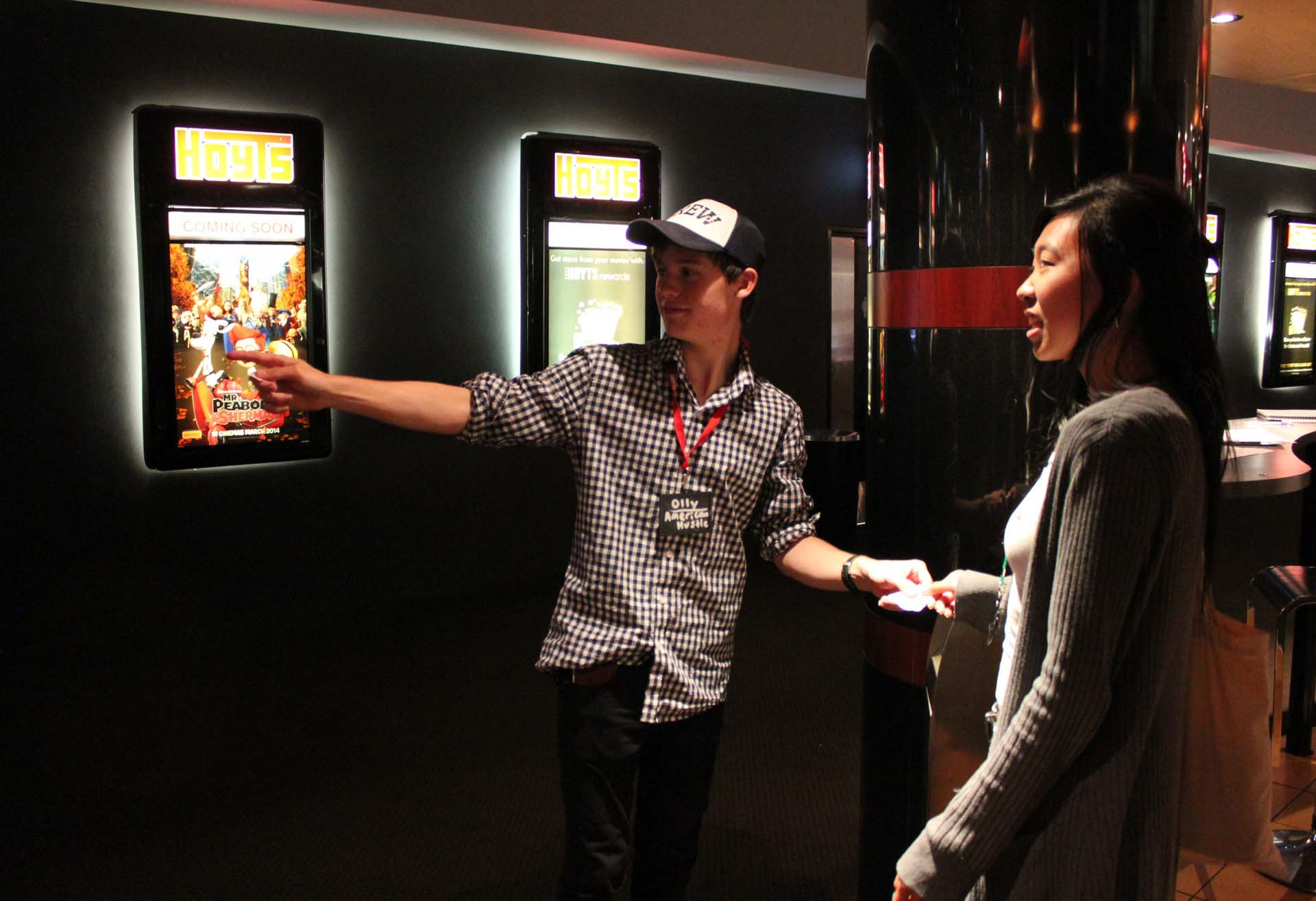 Hoyts employee directing a customer