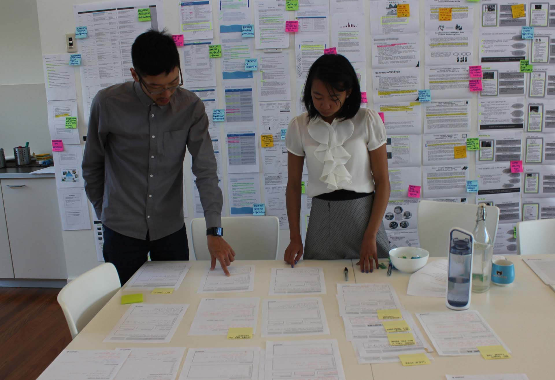 Two proto experience designers analysing research data