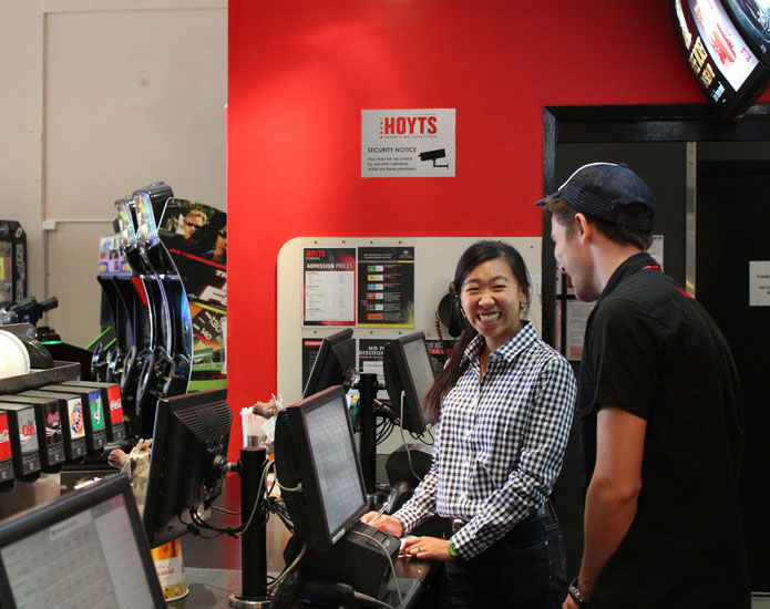 Hoyts employee engaging with Proto member of staff at the ticket register