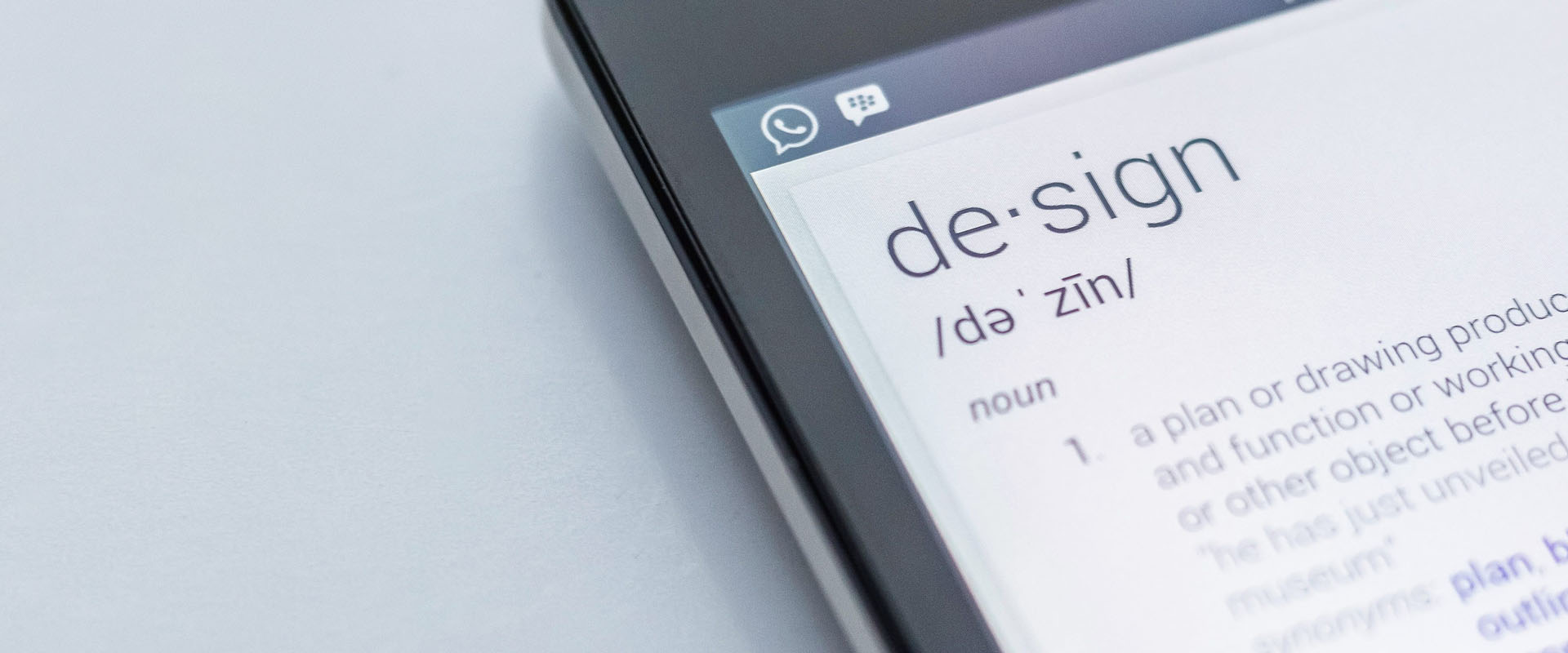 Phone screen displaying the definition of design