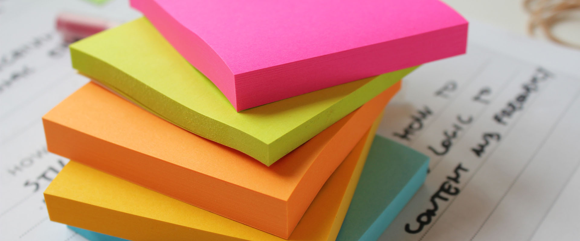 Stacked coloured notepads customer workshop preperation