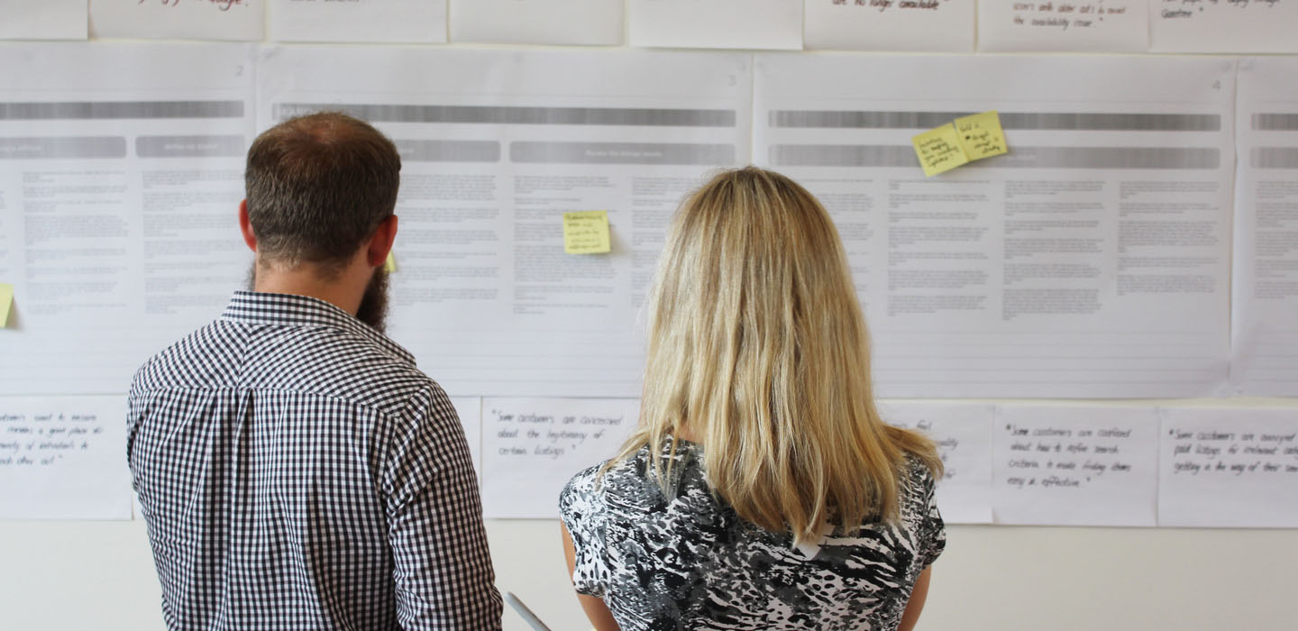 Employees studying customer journey map for CX Change Management